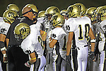 Torrance, CA 11/05/10 - Coach Jim Canetti, Robert Castelao (Peninsula #10), Walter Woo (Peninsula #2), Nathan Jo (Peninsula #12) and unknown Peninsula player(s) in action during the Peninsula vs West varsity football game played at West Torrance high school.