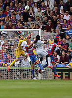 Pictured: Swansea goalkeeper Lukasz Fabianski (L) assisted by team mate Bafetimbi Gomis (8) punches the ball away, threatened by Brede Hangeland and Marouane Chamakh of Crystal Palace<br />