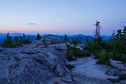 Silhouette of mountain range at sunset from Middle Sister Mountain in Albany, New Hampshire USA during the summer months.