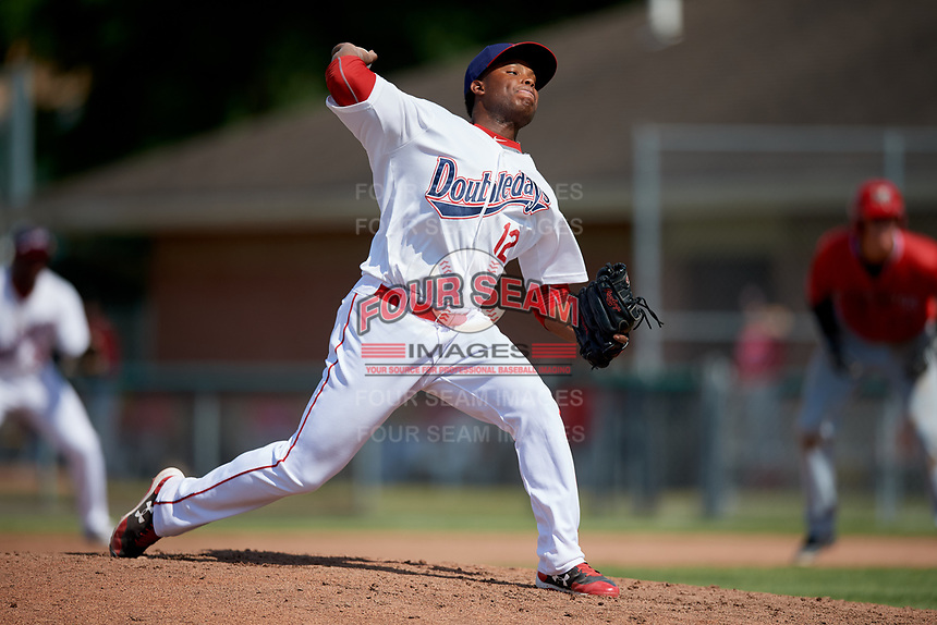 Auburn Doubledays relief pitcher Nector Ramirez (12) delivers a pitch during a game against the Batavia Muckdogs on June 17, 2018 at Falcon Park in Auburn, New York.  Auburn defeated Batavia 10-8.  (Mike Janes/Four Seam Images)