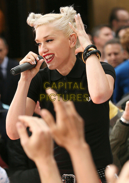 GWEN STEFANI - NO DOUBT .No Doubt performs on NBC's Today Show Concert at Rockefeller Center, New York, NY, USA, .1st May 2009..half length gig live on stage show concert performing microphone black Fred Perry polo t-shirt buttons collar   singing red lipstick hand bracelet .CAP/ADM/AC.©Alex Cole/AdMedia/Capital Pictures
