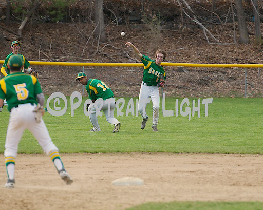 CHS senior right fielder Owen Gannon (right) throws the ball in over freshman second baseman Johan Asencio.