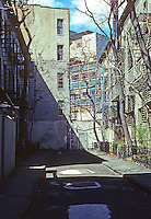 New York City: Patchin Place, Greenwich Village. Ten 3-story brick row houses--hidden place for artists and writers, a Bohemian haunt.  Photo '78.