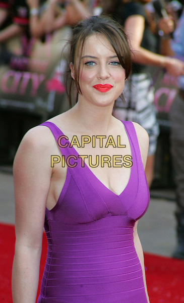 "MICHELLE RYAN .World Premiere of ""Sex and the City - the Movie"" at the Odeon, Leicester Square, London, England, UK, May 12th 2008.half length purple dress Herve Leger  red orange lipstick .CAP/ROS.©Steve Ross/Capital Pictures"