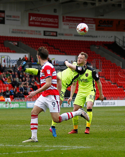April 29th 2017, Doncaster, South Yorkshire, England; Skybet League 2 football, Doncaster Rovers versus Exeter City;Jake Taylor of Exeter City clears to deny John Marquis of Doncaster Rovers a chance to score