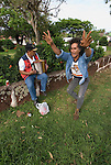 Chile, Easter Island: Two men singing, dancing in Hanga Roa..Photo #: ch348-33586.Photo copyright Lee Foster www.fostertravel.com lee@fostertravel.com 510-549-2202