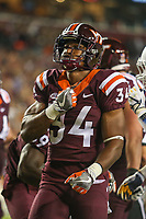 Landover, MD - September 3, 2017: Virginia Tech Hokies running back Travon McMillian (34) pounds his chest after scoring a touchdown during game between Virginia Tech and WVA at  FedEx Field in Landover, MD.  (Photo by Elliott Brown/Media Images International)