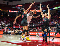 COLLEGE PARK, MD - FEBRUARY 9: Ashley Owusu #15 of Maryland lobs in  shot between Arella Guirantes #24 and Jordan Wallace #44 of Rutgers during a game between Rutgers and Maryland at Xfinity Center on February 9, 2020 in College Park, Maryland.