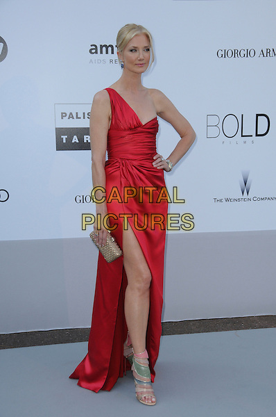 JOELY RICHARDSON.arrivals at amfAR's Cinema Against AIDS 2010 benefit gala at the Hotel du Cap, Antibes, Cannes, France during the Cannes Film Festival.20th May 2010.amfAR full length red one shoulder silk satin dress long maxi side thigh leg split slit hand on hip clutch bag pink beige open toe sandals shoes .CAP/CAS.©Bob Cass/Capital Pictures.