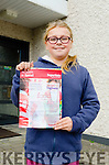 TIDY TOWN HERO: Young Lucy Daly proudly holds her Tidy Town Hero Certificate 2015 at her school in Caher, Kenmare.