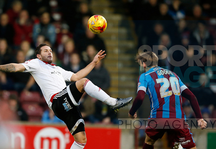 Billy Sharp of Sheffield Utd wins the ball from Charlie Goode of Scunthorpe Utd - English League One - Scunthorpe Utd vs Sheffield Utd - Glandford Park Stadium - Scunthorpe - England - 19th December 2015 - Pic Simon Bellis/Sportimage