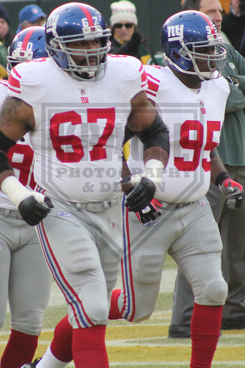 GREEN BAY - January 2012:  Kareem McKenzie (67) and Rocky Bernard (95) of the New York Giants during an NFL Playoff game on January 15, 2012 at Lambeau Field in Green Bay, Wisconsin. (Photo by Brad Krause).