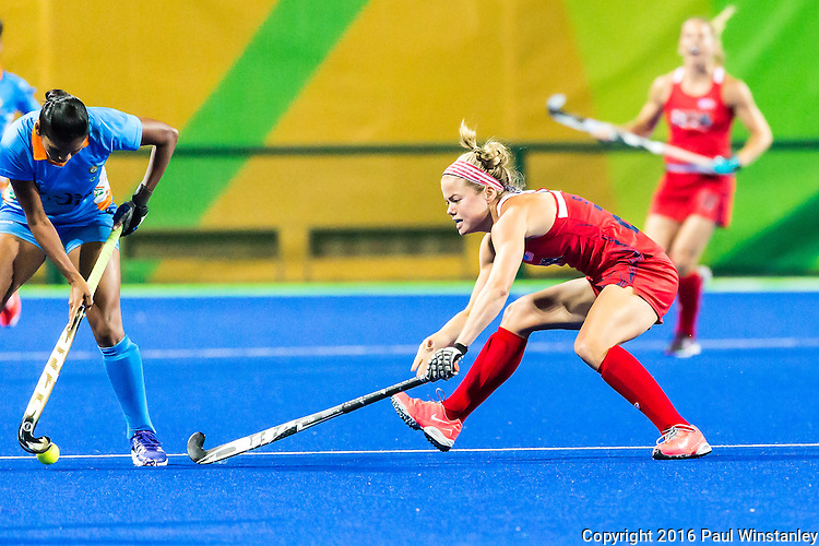 Kathleen Sharkey #24 of United States poke tackles during the USA vs India women's Pool B game at the Rio 2016 Olympics at the Olympic Hockey Centre in Rio de Janeiro, Brazil.