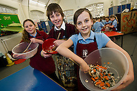 Poppy Squidd (10), Tom Gray (11) and Sophie Collingwood (10), mixing ingredients with Margaret Mountford, an LSA at the school and one of the organisers.???Margaret Mountford, an LSA at Ludlow Junior School in Southampton and Lindsay Bowers, organised for nearly all of school's 640 ish children to mix together the ingredients of a chow mein noodle stir fry and cook them on just three stoves as part of Let's Get Cooking's Big Cookathon.  They had the help of teachers, teaching assistants and a few parents.???UNP 24985/Kindred (London)??Lets Get Cooking, Big Cookathon, Southampton??Let's Get Cooking is organising the second annual 'BIG Cookathon' on Tuesday 16 March, 2010. It will be a national event in which as many clubs as possible across the country will participate in a community cooking activity.??Contact in advance of the day.Ed Callow - Kindred (PR agency).0207 612 8860.07732 088 33???Date Taken: 16/03/10??Location:?Ludlow Junior School, Peveril Road, Southampton, SO19 2DW??Contact:?Lindsay Bowers.07800 565774??Commissioned by:  UNP?Mandy Taylor?UNP Ltd.24 Victoria Road,.Saltaire,.BD18 3JR.England, UK.P 01274 412222.F 01274 590999.iSDN 01274 420446.email: mandy@unp.co.uk
