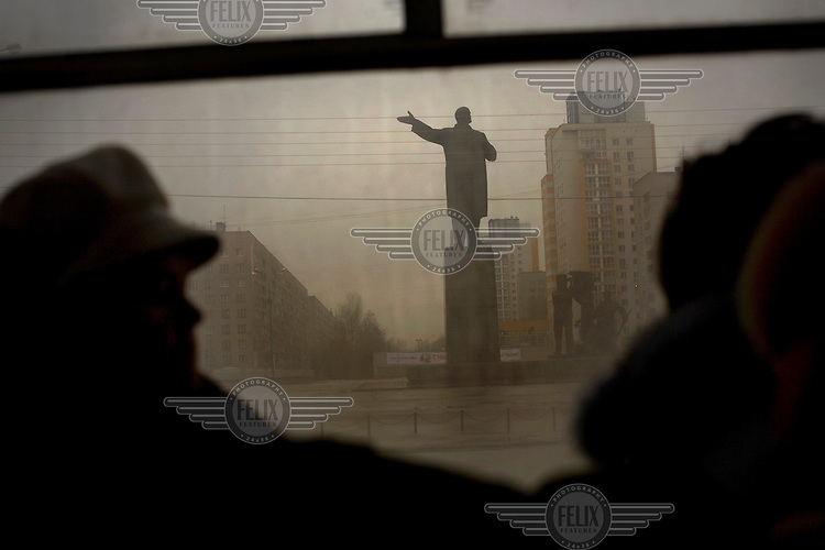 Bus passengers ride past a statue of Lenin in Nizhny Novgorod, Russia's third largest city. Dubbed Russia's third capital, the city of 1.3 million was closed to foreigners for many decades because of its connection with the military.