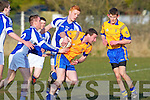 Ballymac's Maurice Shanahan gets away from Templenoe's KIeran McCarthy and Teddy Doyle in the division 3 clash at Ballymac on Saturday.