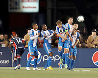 New England Revolution free kick hits the Philadelphia Union wall. Philadelphia Union substitute midfielder Jose Kieberson (19), Philadelphia Union defender Raymon Gaddis (28), Philadelphia Union midfielder Brian Carroll (7), Philadelphia Union substitute forward Sebastien Le Toux (11), and Philadelphia Union forward Jack McInerney (9).In a Major League Soccer (MLS) match, the New England Revolution (blue/red) defeated Philadelphia Union (blue/white), 2-0, at Gillette Stadium on April 27, 2013.