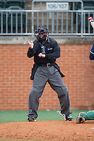Home plate umpire Gary Swanson makes a strike call during the NCAA baseball game between the Akron Zips and the Charlotte 49ers at Hayes Stadium on February 22, 2015 in Charlotte, North Carolina.  The Zips defeated the 49ers 5-4.  (Brian Westerholt/Four Seam Images)