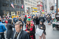 Crowds of shoppers on Fifth Avenue in Midtown Manhattan in New York on Saturday, December 10, 2016. Only fifteen more days until Christmas.  (© Richard B. Levine)