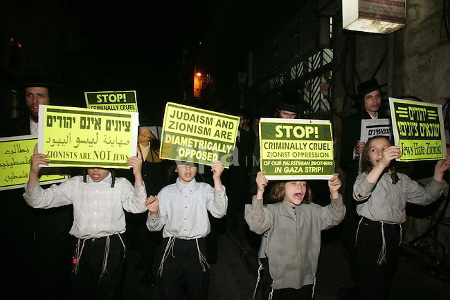 Ultra Orthodox Haredi Jews of the Neturei Karta group take part in a protest against Israeli attacks over Gaza Strip in the west of Jerusalem on Aug. 21, 2011. Photo by Mahfouz Abu Turk