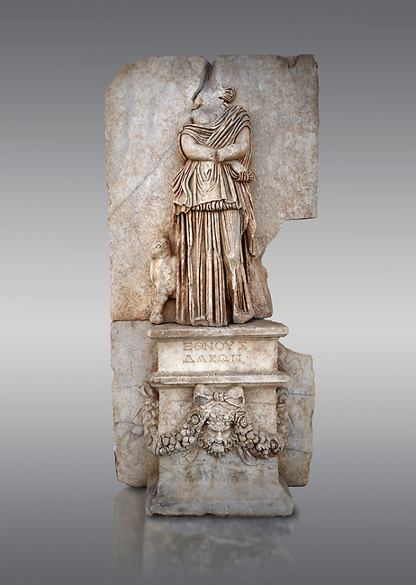 Roman Sebasteion relief sculpture of Ethnos of the Dacians Aphrodisias Museum, Aphrodisias, Turkey. <br /> <br /> The Dacians are shown as a captive Barbarian woman. Her arms are crossed in submission, her thick dress slips off the shoulder slightly partly revealing her breast. The forepart of a small bull stands in profile behind. Dacia (modern Romania) was claimed by Augustus as a conquest in 1BC to 4AD
