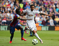 Pictured L-R: Pape Souare of Crystal Palace challenges Kyle Naughton of Swansea<br />