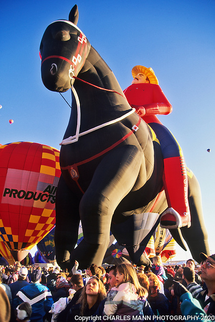 At the Albuquerque International Hot Air Balloon Fiesta a Royal Canadian Mounted Police balloon rises over the crowd during a mass ascension.