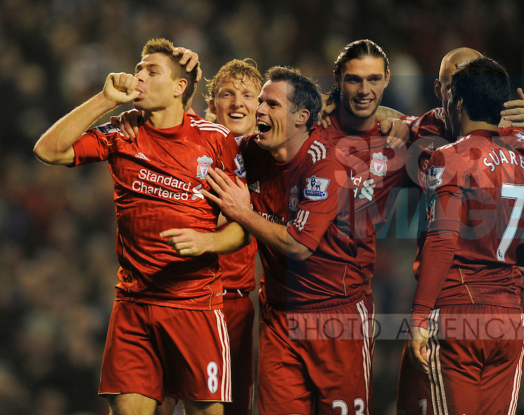 Steven Gerrard of Liverpool celebrates his hat rick goal.Barclays Premier League match between Liverpool v Everton at Anfield, Liverpool on the 13th March 2012..Sportimage +44 7980659747.picturedesk@sportimage.co.uk.http://www.sportimage.co.uk/.