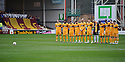MOTHERWELL PLAYER OBSERVE A MINUTES SILENCE IN HONOUR OF BILL DICKIE WHO DIED LAST WEEK...14/01/2012 sct_jsp022_motherwell_v_ict     .Copyright  Pic : James Stewart.James Stewart Photography 19 Carronlea Drive, Falkirk. FK2 8DN      Vat Reg No. 607 6932 25.Telephone      : +44 (0)1324 570291 .Mobile              : +44 (0)7721 416997.E-mail  :  jim@jspa.co.uk.If you require further information then contact Jim Stewart on any of the numbers above.........