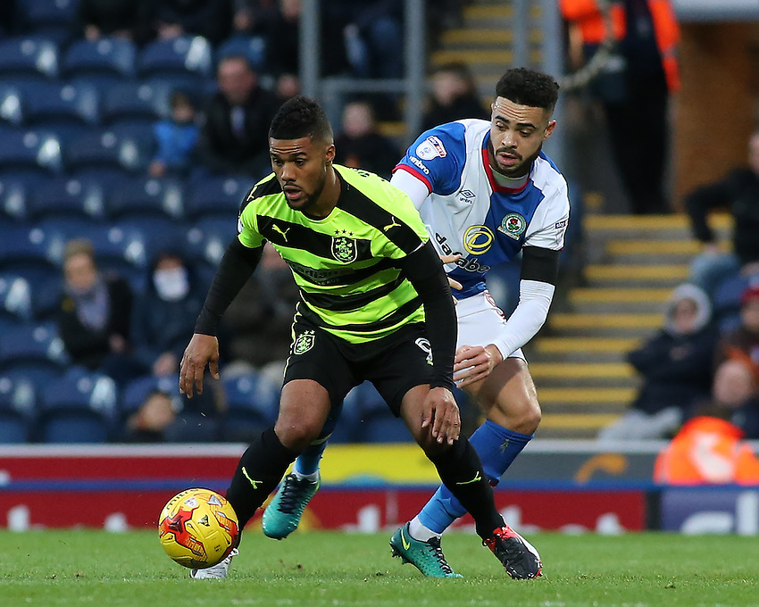 Huddersfield Town's Elias Kachunga battles with Blackburn Rovers' Derrick Williams<br /> <br /> Photographer David Shipman/CameraSport<br /> <br /> The EFL Sky Bet Championship - Blackburn Rovers v Huddersfield Town - Saturday 3rd December 2016 - Ewood Park - Blackburn<br /> <br /> World Copyright &copy; 2016 CameraSport. All rights reserved. 43 Linden Ave. Countesthorpe. Leicester. England. LE8 5PG - Tel: +44 (0) 116 277 4147 - admin@camerasport.com - www.camerasport.com
