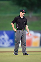 Umpire Sam Burch handles the calls on the bases during the South Atlantic League game between the Delmarva Shorebirds and the Kannapolis Intimidators at Kannapolis Intimidators Stadium on July 3, 2017 in Kannapolis, North Carolina.  The Shorebirds defeated the Intimidators 5-2.  (Brian Westerholt/Four Seam Images)