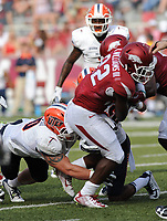 NWA Democrat-Gazette/ANDY SHUPE<br /> Arkansas' Rawleigh Williams III (right) is brought down by University of Texas at El Paso's Jimmy Musgrave Saturday, Sept. 5, 2015, during the fourth quarter of play in Razorback Stadium in Fayetteville. Visit nwadg.com/photos to see more from the game.