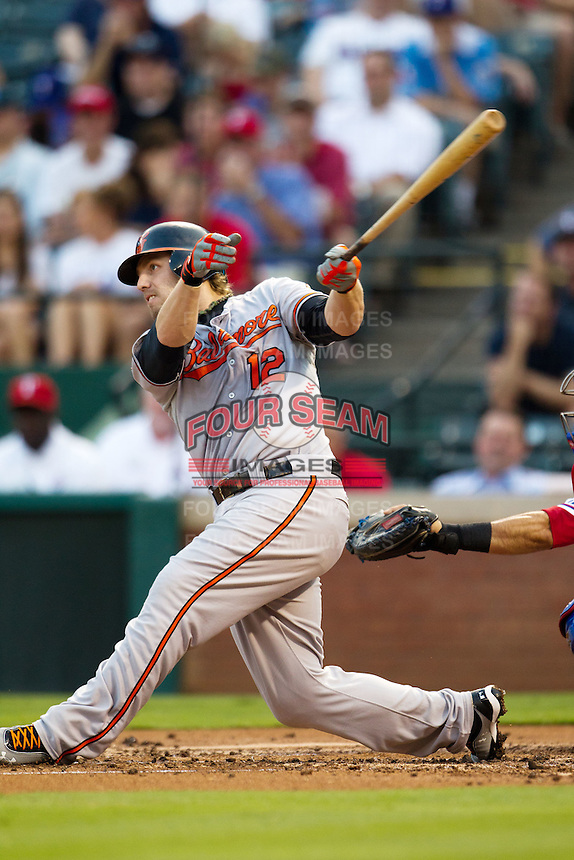 Baltimore Orioles first baseman Mark Reynolds #12 swings during the Major League Baseball game against the Texas Rangers on August 21st, 2012 at the Rangers Ballpark in Arlington, Texas. The Orioles defeated the Rangers 5-3. (Andrew Woolley/Four Seam Images).
