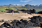 Hiking amid the Lava Formations along the Beach in the Former Fishing Village of Budir in West Iceland