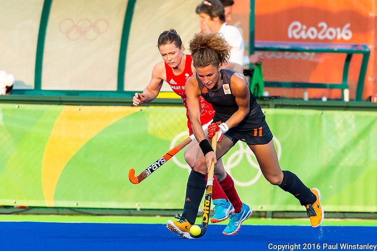 Maria Verschoor #11 of Netherlands protects the ball during Netherlands vs Great Britain in the gold medal final at the Rio 2016 Olympics at the Olympic Hockey Centre in Rio de Janeiro, Brazil.