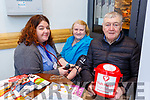 Patricia Foley gets her blood pressure checked by Orla Buckley and Brendan McCArthy and the Heartbeat pop up stand in Dunnes Stores Killarney on Friday