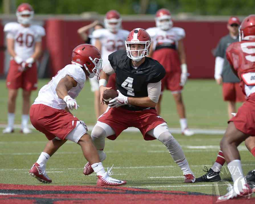 NWA Democrat-Gazette/ANDY SHUPE<br /> Arkansas quarterback Ty Storey looks to run Tuesday, Aug. 7, 2018, during practice at the university practice fields in Fayetteville. Visit nwadg.com/photos to see more photographs from the practice.