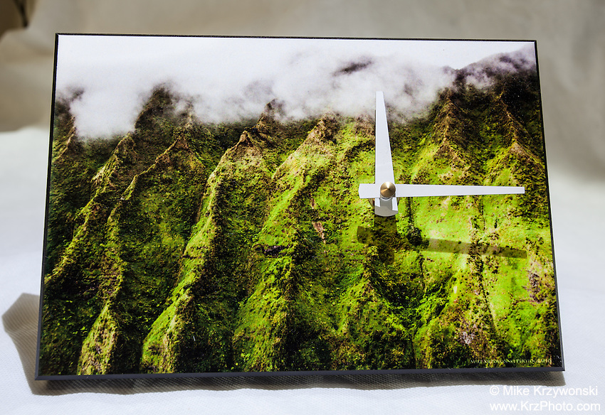 KO'OLAU MOUNTAINS CLOCK $40<br /> With an attachable stand, it can be used as a desk or wall clock. Requires one AA battery. 5.5&quot; x 8&quot; x .75&quot;<br /> Contact me to order.