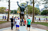 People gather near the Rocky statue at the base of the Philadelphia Museum of Art on Benjamin Franklin Parkway in  Philadelphia, Pennsylvania, USA.