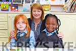 Junior infants Jovia Kiwanuka and Grace Power In St John's Parochial NS Tralee with their teacher Ms Fitzell.