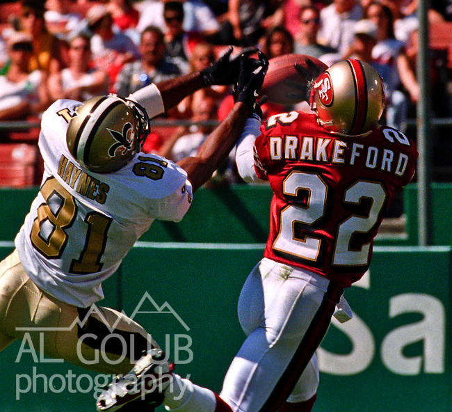 San Francisco 49ers vs.New Orleans Saints at Candlestick Park Sunday, September 1, 1996.  49ers beat Saints  27-11.  San Francisco 49ers defensive back Tyronne Drakeford (22) intercepts pass intended for New Orleans Saints wide receiver Michael Haynes (81).