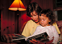 grandmother reading to child. United States.