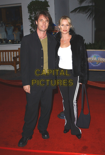 JAMES WILDER, NICOLLETTE SHERIDAN.Bruce Almighty LA Film Premiere, USA, 14th May 2003..full length Nicolette black jacket tracksuit pants bottoms trousers white stripes side.www.capitalpictures.com.sales@capitalpictures.com.©Debbie Van Story/Capital Pictures.