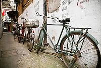 Bicycles parket in alleyway, Shanghai, China