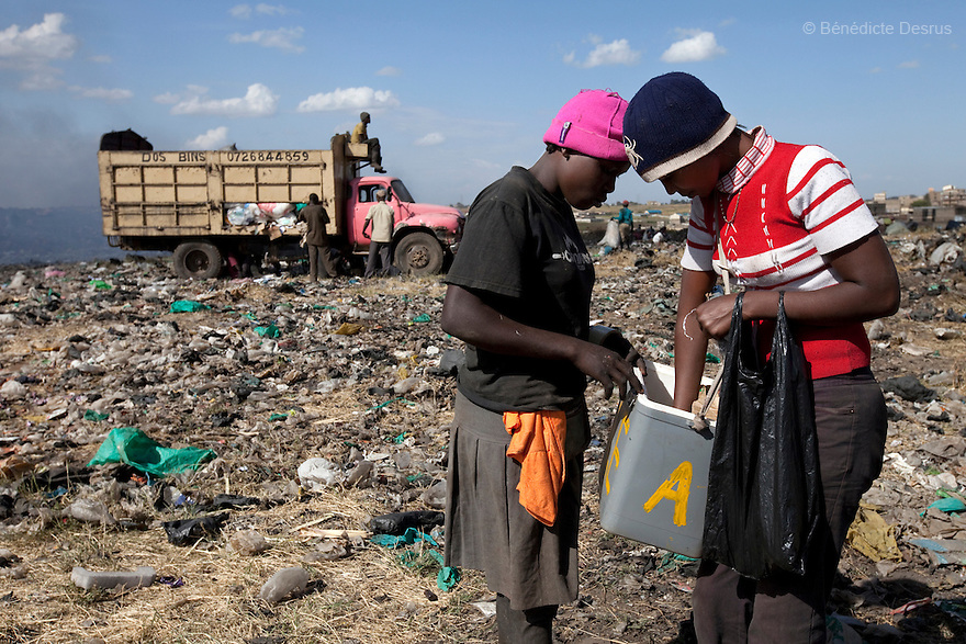 13 february 2013 - Dandora dumpsite, Nairobi, Kenya - A young Kenyan woman buys an ice-cream at the Dandora dumpsite, one of the largest and most toxic in Africa. Located near slums in the east of the Kenyan capital Nairobi, the open dump site was created in 1975 and covers 30 acres. The site receives 2,000 tonnes of unfiltered garbage daily, including hazardous chemical and hospital wastes. It is a source of survival for many people living in the surrounding slums, however it also harms children and adults' health in the area and pollutes the Kenyan capital. Photo credit: Benedicte Desrus