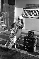 INDIANAPOLIS, IN - MAY 31: Bill Simpson, founder of Simpson Safety Equipment, demonstrates the effectiveness of his fire suit after practice for the Indianapolis 500 USAC Indy Car race at the Indianapolis Motor Speedway in Indianapolis, Indiana, on May 31, 1986.