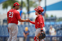 Palm Beach Cardinals relief pitcher Junior Fernandez (23) and catcher Alexis Wilson (26) shake hands after closing out a a Florida State League game against the Charlotte Stone Crabs on April 14, 2019 at Charlotte Sports Park in Port Charlotte, Florida.  Palm Beach defeated Charlotte 5-3.  (Mike Janes/Four Seam Images)