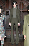 """Model Sarah poses in a loden stretch techno wool faux double breasted blazer, loden stretch techno wool skinny flare trouser, and army green cashmere mixed weight ribbed turtleneck, from the Veronica Beard Fall 2016 """"Gypsy Caravan"""" collection presentation, at the Highline Hotel on February 15 2016, during New York Fashion Week Fall 2016."""