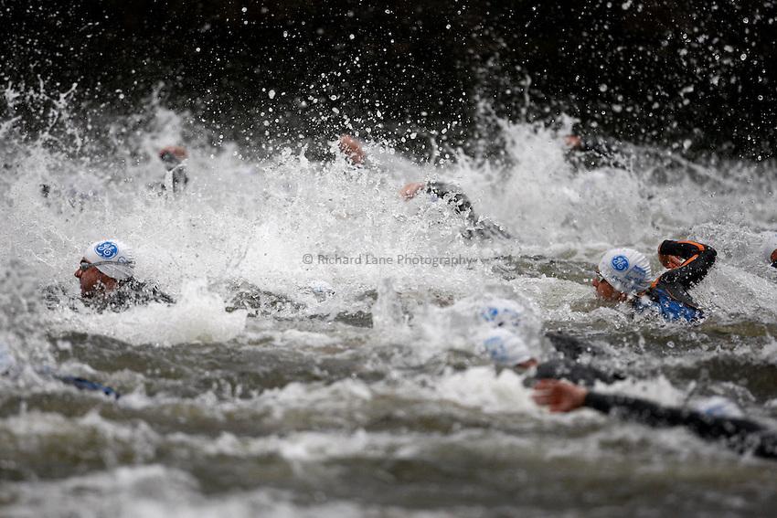 Photo: Richard Lane/Richard Lane Photography. GE Parc Bryn Bach Triathlon. 19/09/2010. Competitiors swim in the Elite Mens' race.