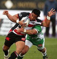 Counties hooker Notise Tauafao tries to escape the tackle of Doug Tietjens during the Air NZ Cup rugby match between Manawatu Turbos and Counties-Manukau Steelers at FMG Stadium, Palmerston North, New Zealand on Sunday, 2 August 2009. Photo: Dave Lintott / lintottphoto.co.nz